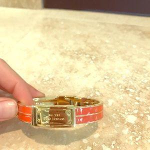 Orange and gold snap closure Michael Kors bracelet